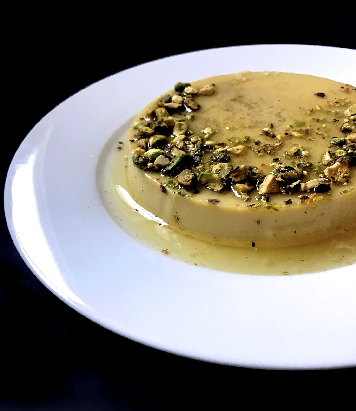 Cardamom Crème Caramel with Roasted Pistachios | Creamy and smooth crème caramel infused with cardamom and topped with roasted pistachios.